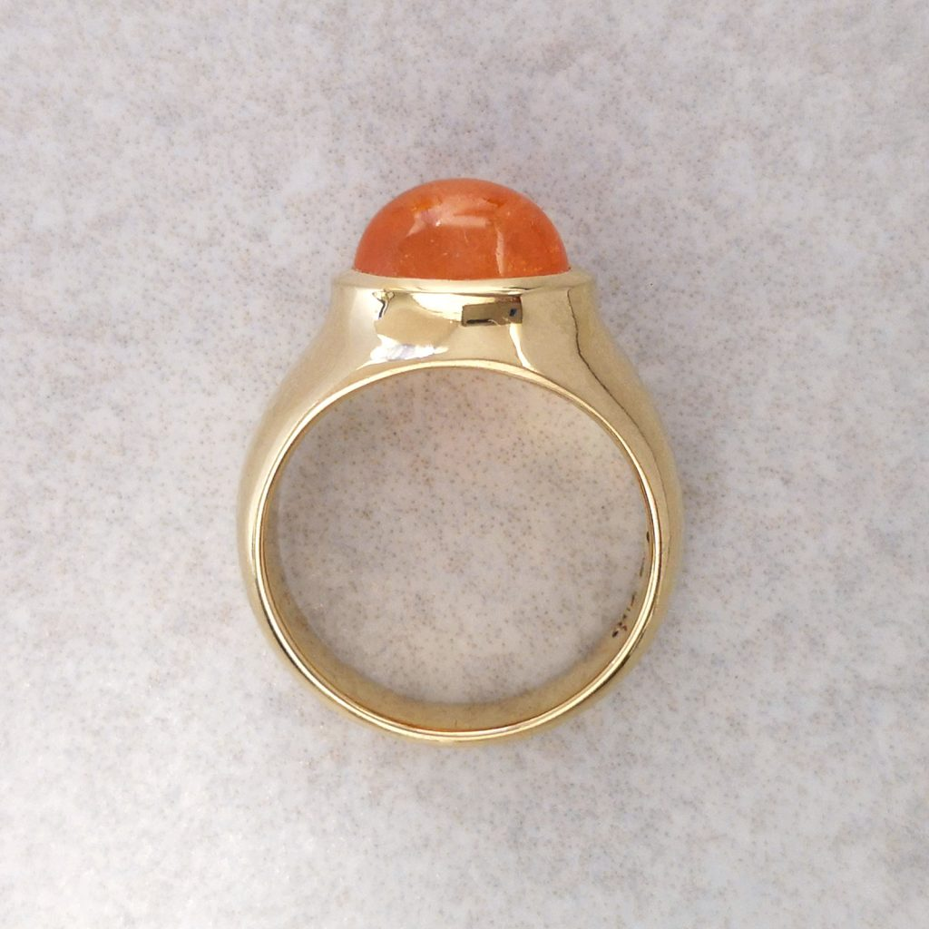 "18ct Gold and Mandarin Garnet ""Ember"" Ring -- A warm combination of colour in this beautifully tactile ring. The weight, curves and colour make it a pleasure to wear. Set with an oval mandarin garnet measuring 10mm X 8mm. Finger size: M ½. David Wilson Jewellery Shop"