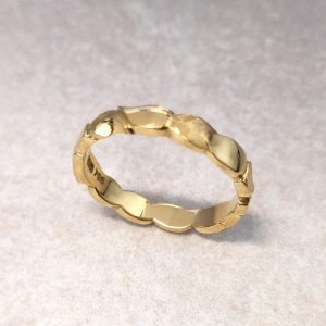 "18ct Gold ""Leaf"" Ring -- The hand carved and textured leaves of this band would make a beautiful alternative wedding ring. Measures at its maximum 3.4mm by 1.6mm. Finger size: N. Can be made to other dimensions and materials. Get in touch for details. David Wilson Jewellery Shop"