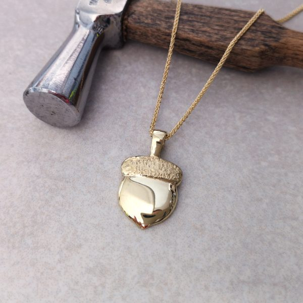 """9ct Gold Acorn Pendant -- """"The boughs of the oak are roaring inside the acorn"""" – Charles Tomlinson. A wonderful symbol of potential and strength this acorn pendant makes a lovely gift for the person you see those qualities in. Beautifully weighted pendant measures 21mm by 13mm comes on an 18 inch spiga chain. David Wilson Jewellery Shop"""