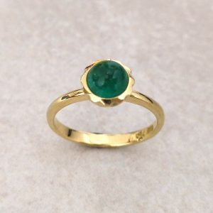 "18ct Gold Emerald ""Cupola"" Ring -- A beautiful emerald cabochon framed in a scalloped bezel on an elegant shank. It's hard to beat the colour combination of emerald and yellow gold but we can make this ring with any gemstone you can imagine, just get in touch. Emerald measures 6mm diameter. Finger Size: M ½. David Wilson Jewellery Shop"