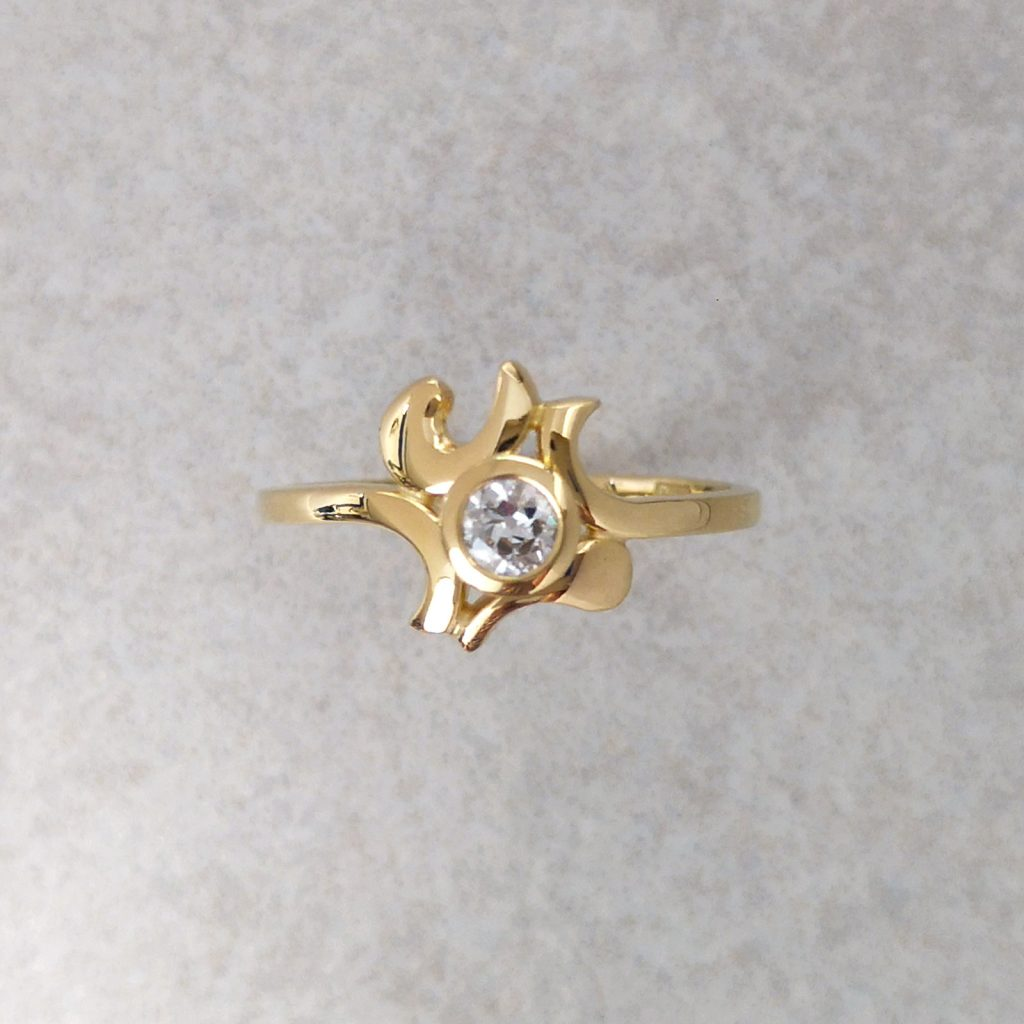 "18ct Gold and Old Cut Diamond ""Bombora"" Ring -- An old cut diamond is bezel set in the heart of waves of gold that make up this ""Bombora"" ring. Handmade by David Wilson, can be made with a variety of Gemstones. Diamond measures 3.5mm in Diameter. Finger Size: L ½. David Wilson Jewellery Shop"