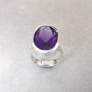 Silver Half Bezel Ring with Amethyst -- A large, well-cut oval amethyst measuring 19mm X 13mm set in a half Bezel. Sterling silver handmade by David Wilson. This is quite the statement ring. Finger size: O ½. David Wilson Jewellery Shop