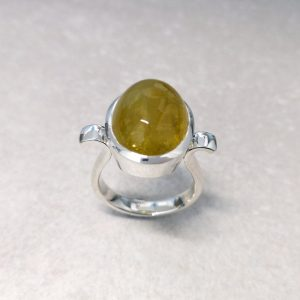 Sterling Silver Heliodor Ring -- This oval cabochon heliodor is set in a tapered bezel with an upswept shank. Handmade by David Wilson. One for your right hand. Gemstone measures 17.5mm by 13mm. Finger size: R. David Wilson Jewellery Shop