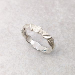 """Sterling Silver """"Leaf"""" Band -- The hand carved and textured leaves of this band would make a beautiful alternative wedding ring. Measures at its maximum 3.5mm by 1.5mm. Finger size: L ½. David Wilson Jewellery Shop"""