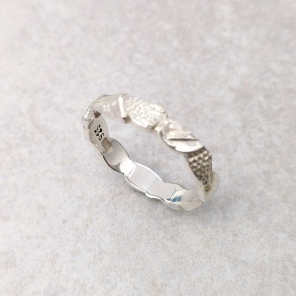 "Sterling Silver ""Leaf"" Band -- The hand carved and textured leaves of this band would make a beautiful alternative wedding ring. Measures at its maximum 3.5mm by 1.5mm. Finger size: L ½. David Wilson Jewellery Shop"