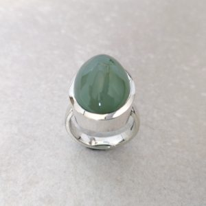 "Seafoam Chalcedony Ring -- A large oval ""seafoam green"" chalcedony set in a tapered full bezel. Handmade in sterling silver. A cool, calming, understated colour in a bold confident ring. Gemstone measures 21mm x 14mm. Finger Size: N. David Wilson Jewellery Shop"