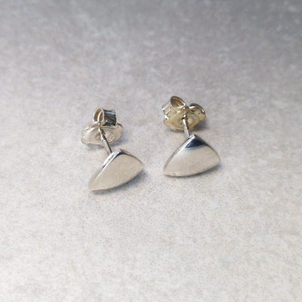 Silver Trillion Ear Studs -- These handmade sterling silver trillion ear studs are simple yet make a great impact. They measure 9mm by 9mm and come with large earring backs for safety and comfort. David Wilson Jewellery Shop